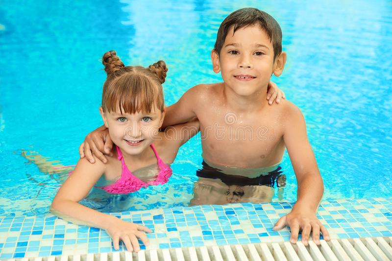 Happy children resting together stock images
