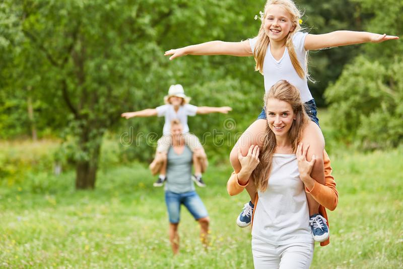 Happy children ride piggyback royalty free stock photography