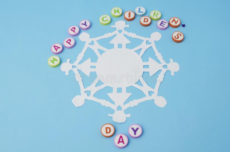 Happy Children`s Day made from colorful letters and paper doll chain stock photos
