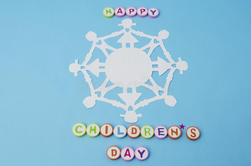 Happy Children`s Day made from colorful letters and paper doll chain royalty free stock images