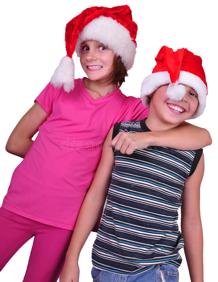 Happy children with Santa Claus red hats stock photography