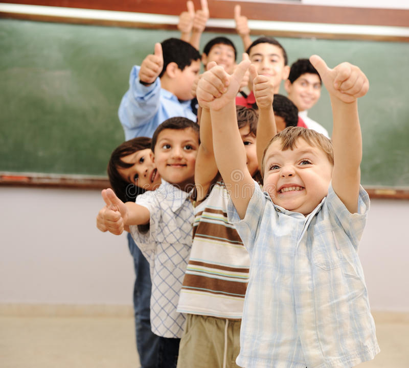 Children at school classroom stock photos