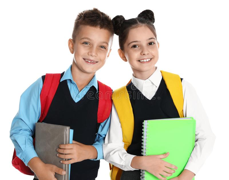 Happy children in  uniform on white background royalty free stock image