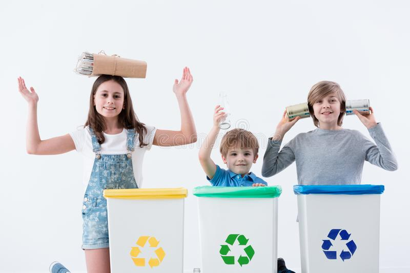 Happy children segregating household waste royalty free stock photography