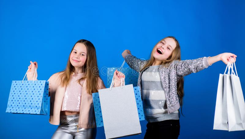 Happy children in shop with bags. Shopping is best therapy. Shopping day happiness. Sisters shopping together. Buy stock photography