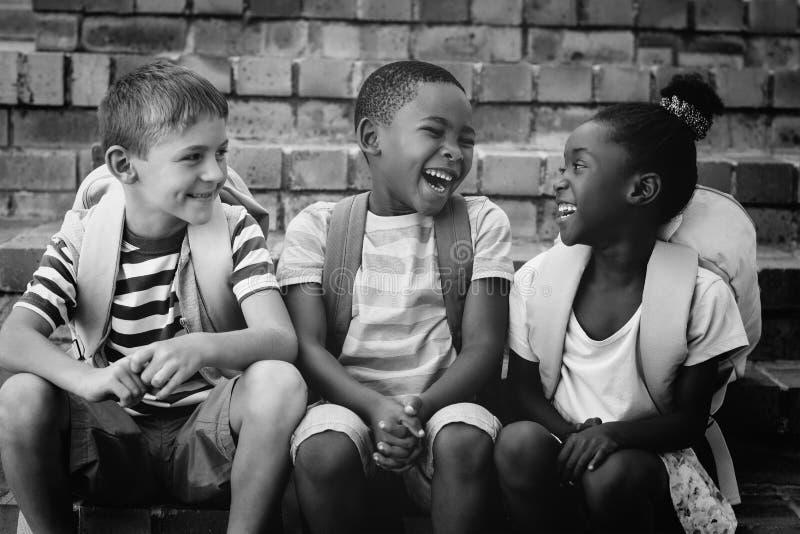 Happy children sitting on steps royalty free stock image