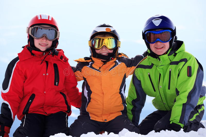 Happy children in ski clothing royalty free stock images