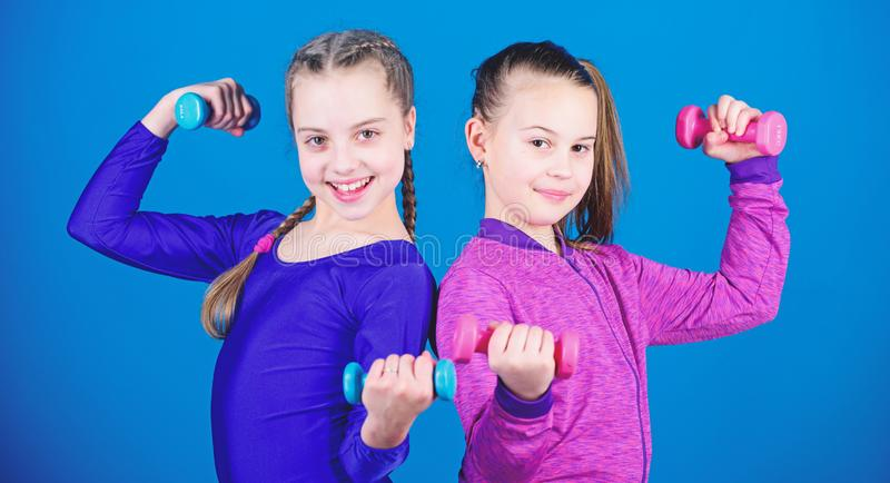 Happy children sportsman with barbell. Sport success. weight lifting for muscules. Childhood activity. Fitness diet for stock photography