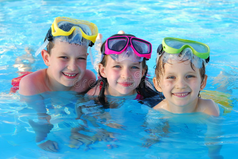 Happy children swimming royalty free stock photography