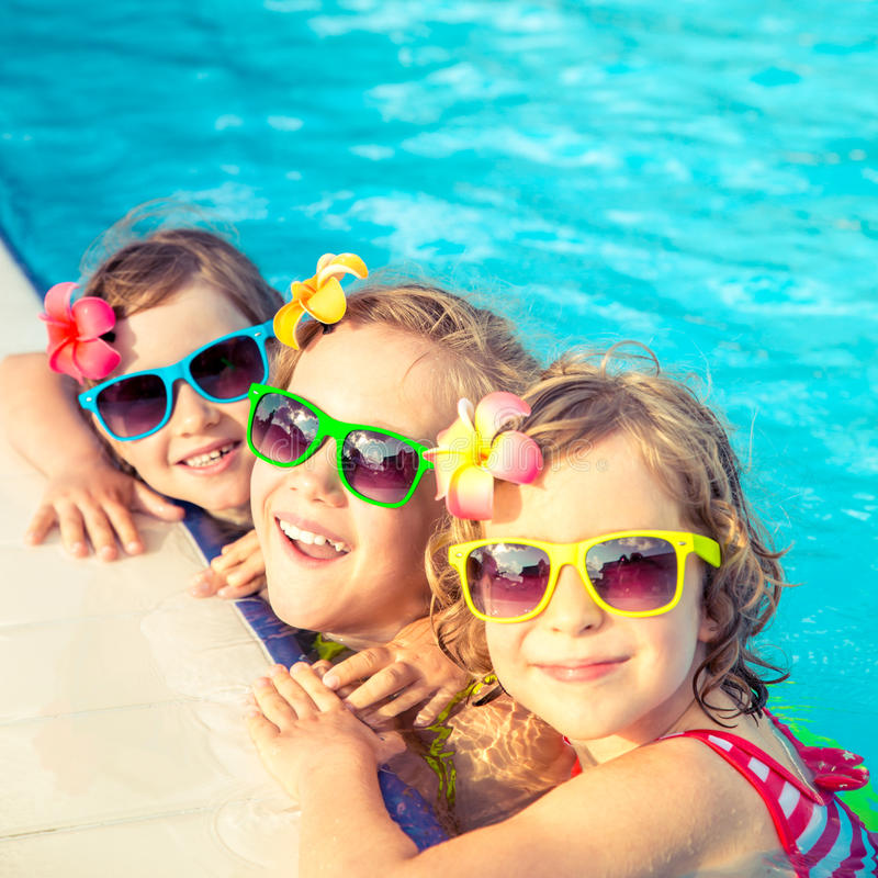 Happy children in the swimming pool royalty free stock images