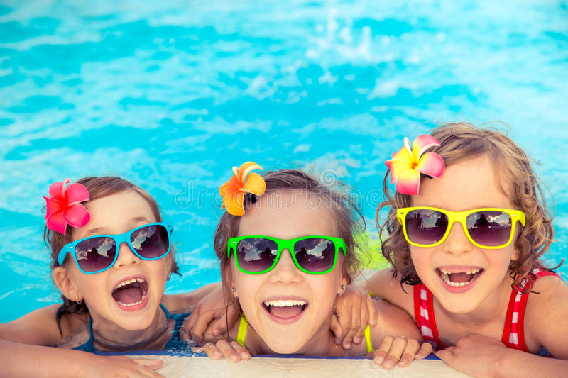 Happy children in the swimming pool royalty free stock photo