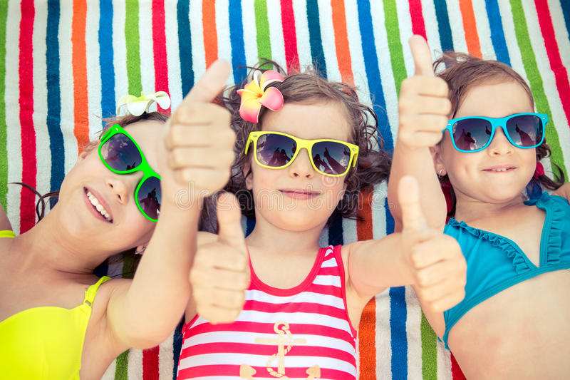 Happy children in the swimming pool royalty free stock photography