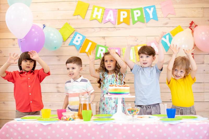 Happy children celebrating birthday holiday stock images