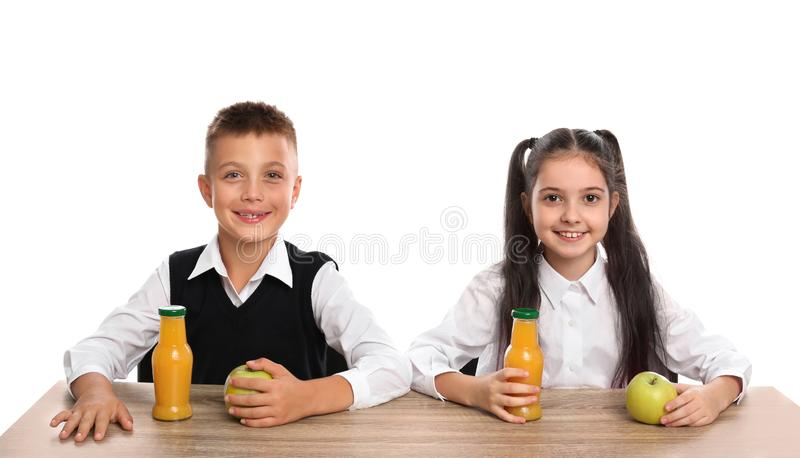 Happy children at  table with healthy food on white background royalty free stock images