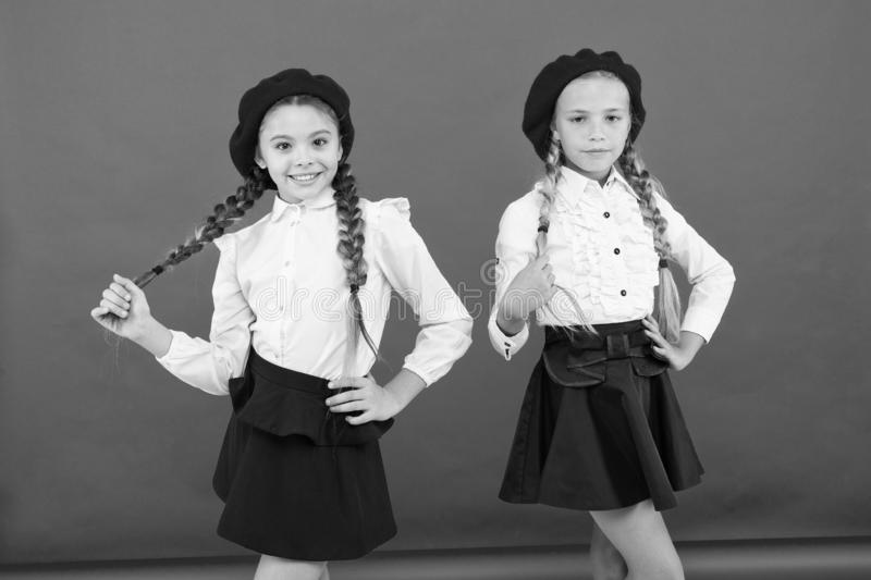 Happy children in uniform. little girls in french beret. Education abroad. kid fashion. friendship and sisterhood. best. Friends. International exchange school stock images