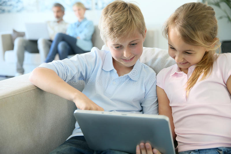 Happy children using tablet at home royalty free stock image