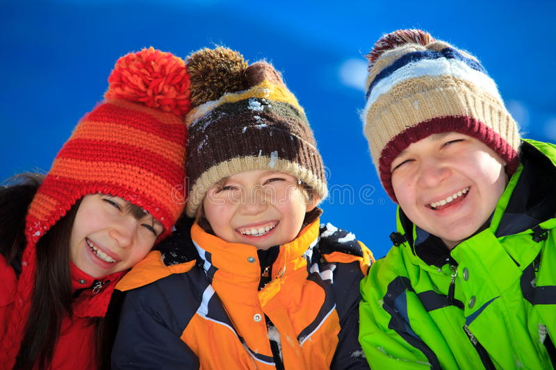 Happy children in Winter royalty free stock images
