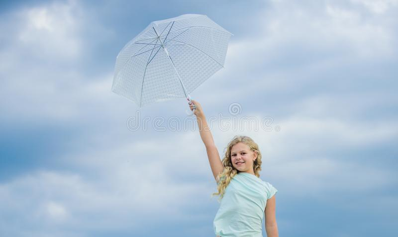 Happy childrens day. Enjoying ease. Carefree child outdoors. Weather forecast. Ready for any weather. Weather changing. Fresh air. Girl with umbrella cloudy royalty free stock photography
