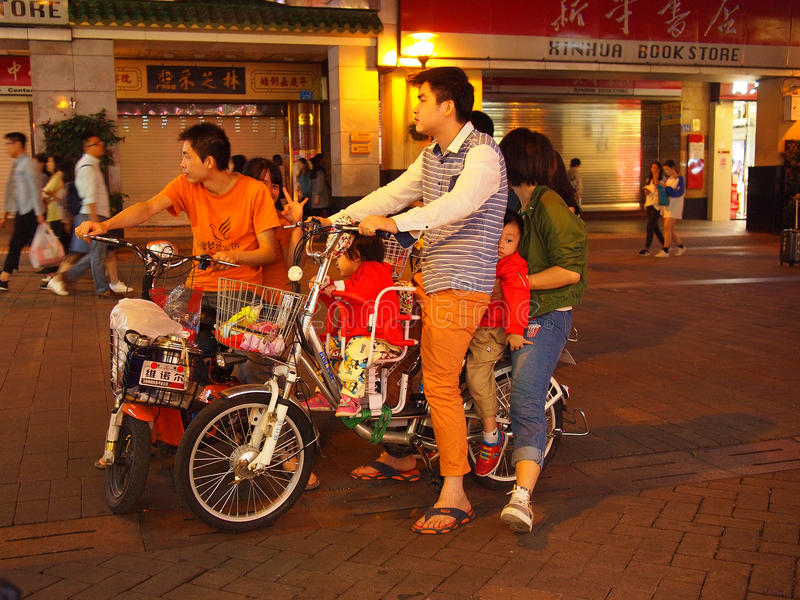 Happy Chinese family riding bike stock images