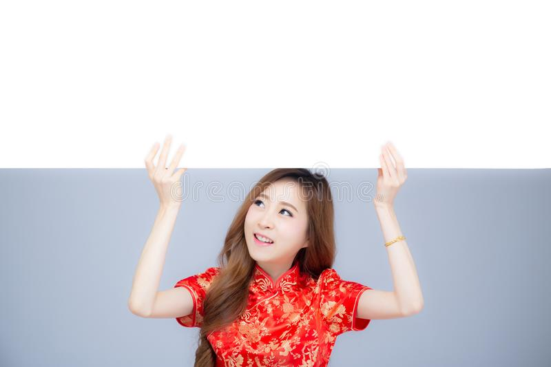 Happy Chinese New Year beautiful portrait young asian woman holding board isolated on white background royalty free stock photography