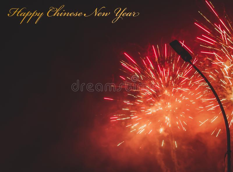 Happy Chinese New Year greeting card or template with yellow golden text and red firework stock photos
