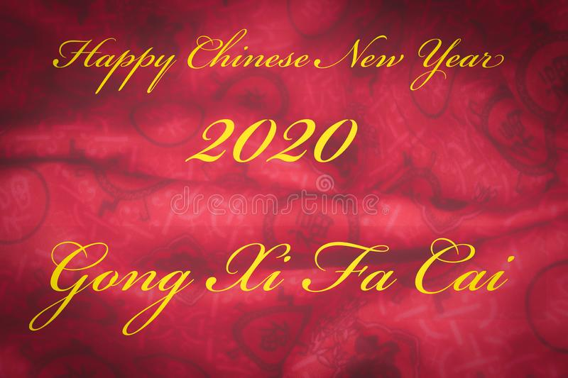 Happy Chinese new year greeting card with yellow gold text Gong Xi Fa Cai on red fabric background royalty free stock images