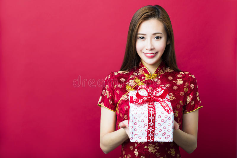 Happy chinese new year.young woman holding gift box royalty free stock photography