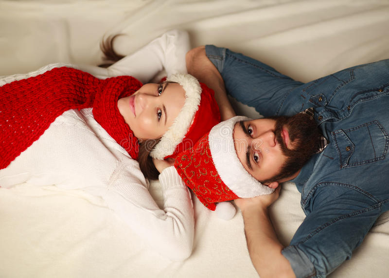 Happy Christmas couple resting at home royalty free stock photos