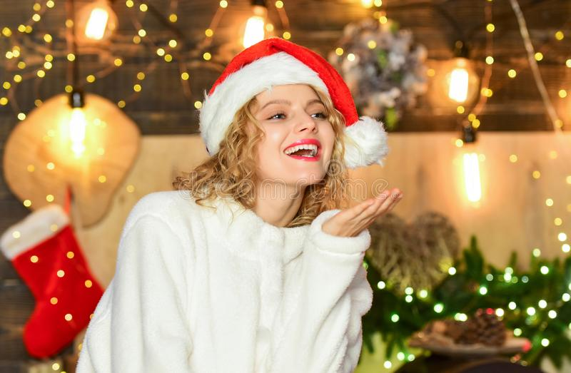 Happy christmas eve. Girl adorable smiling face Santa claus hat enjoy season. Festive mood concept. Do something. Exciting and crazy to remember the festive stock photos