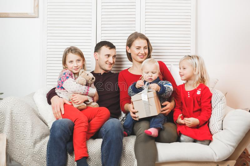 Happy Christmas Family with Kids opening Gift.  royalty free stock photos