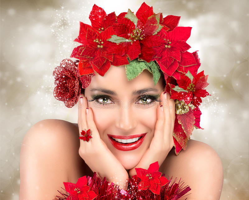 Happy Christmas Girl. Beautiful Woman in red. Holiday Hairstyle royalty free stock images