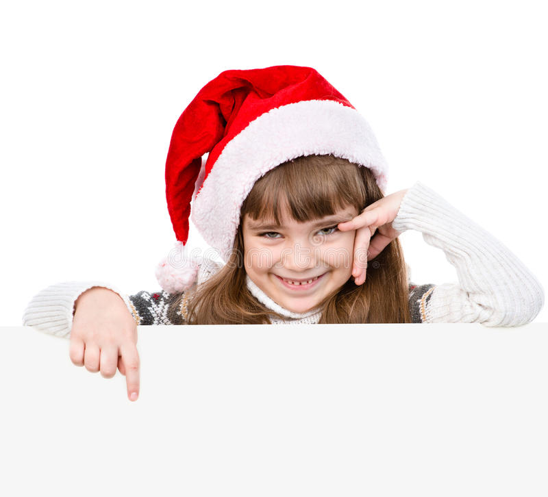 Happy Christmas girl with santa hat points down. isolated on white background stock image