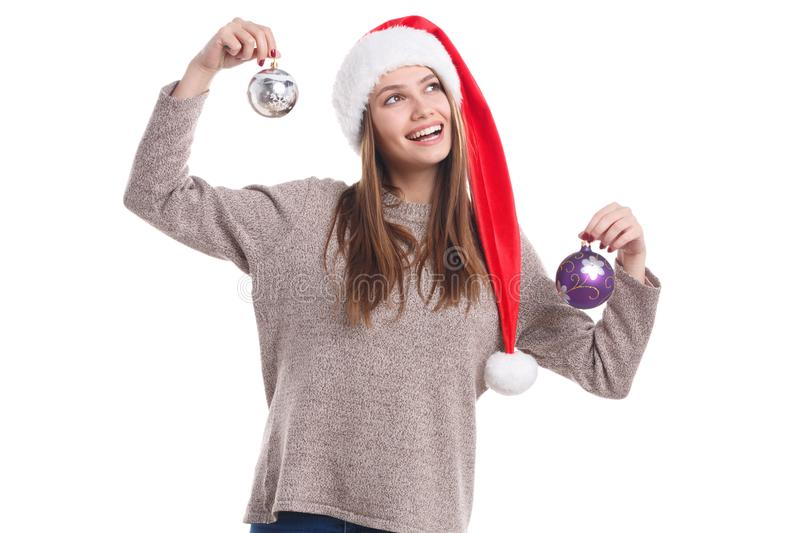 Happy christmas girl wearing a santa hat isolated on a white background. Holidays concept. royalty free stock photography