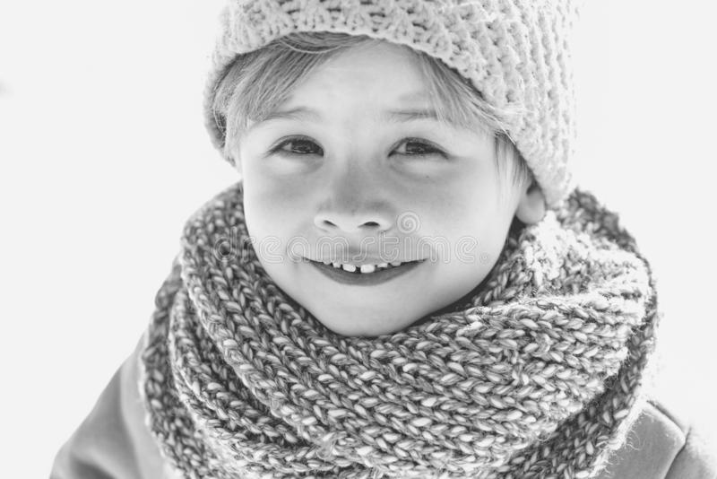 Happy christmas kid. Happy winter child snow background. Cute boy in winter clothes hat and scarf close up. Winter. Fashion. Black and white photo stock images