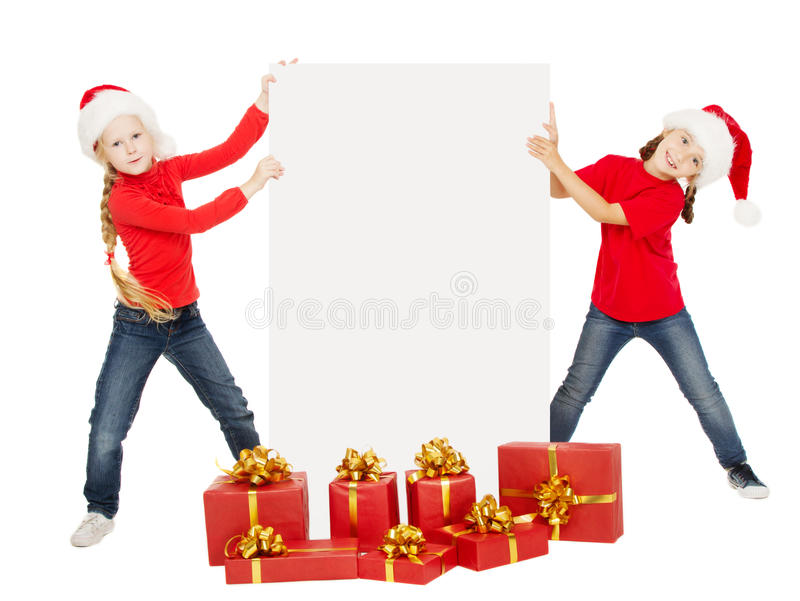 Happy Christmas kids holding banner. Santa helpers with poster stock photo