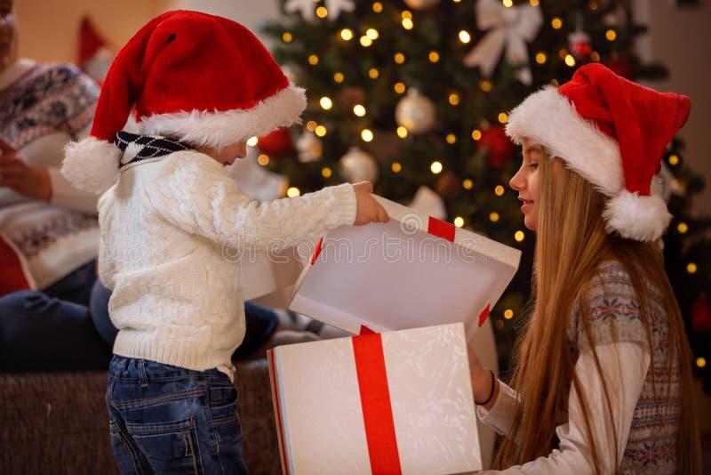 Happy Christmas - Kids opening Christmas gift royalty free stock photo