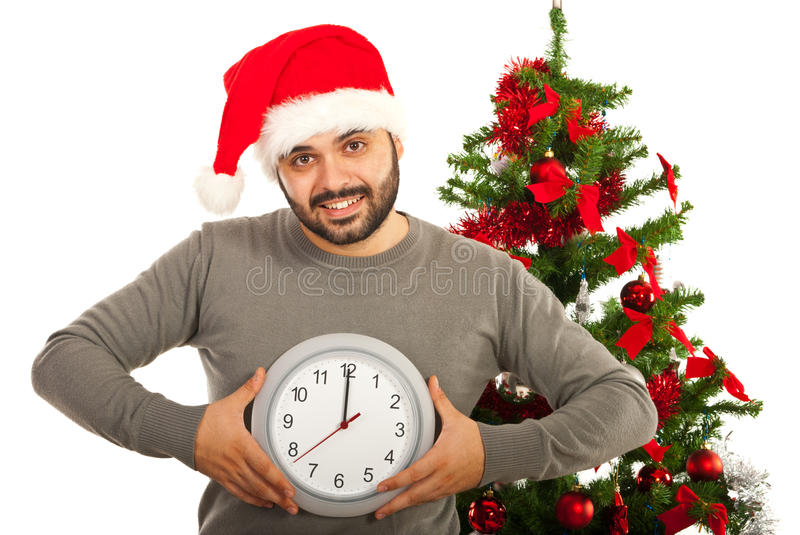 Happy Christmas man. Holding clock isolated on white background stock image