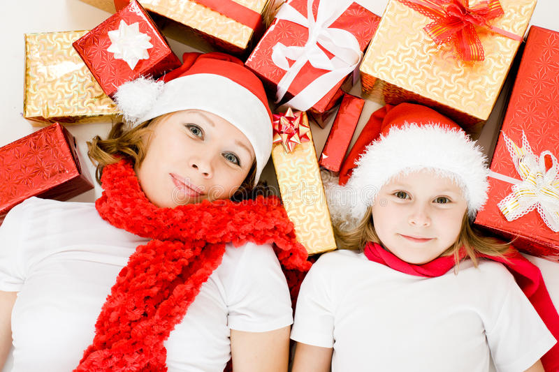 Happy Christmas mother and daughter with presents stock photos