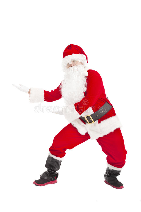 Happy Christmas Santa Claus dancing. Isolated stock photography