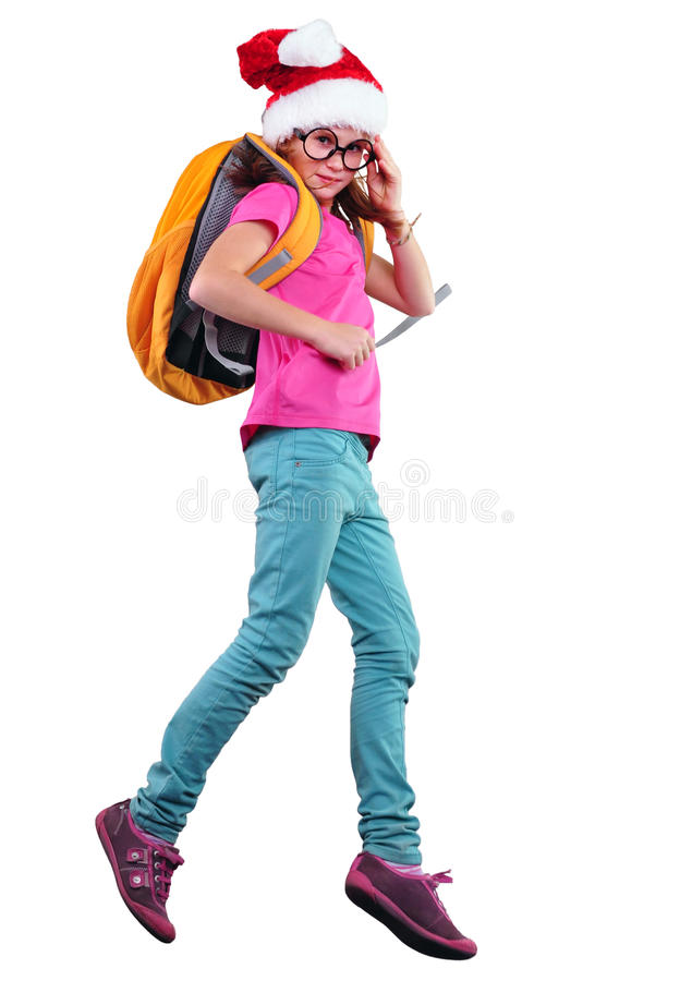 Happy Christmas schoolgirl or traveler exercising, running and jumping stock image
