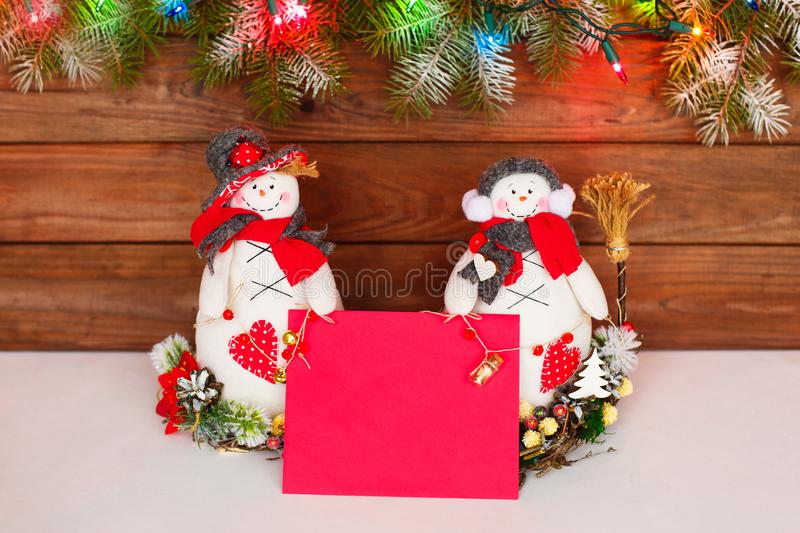 Happy Christmas snowman. Christmas decoration on a wooden background. Greeting card. Xmas decoration. Merry Christmas and a happy New Year card with snowmans stock images