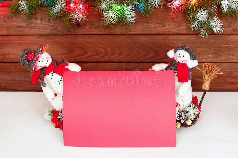 Happy Christmas snowman. Christmas decoration on a wooden background. Greeting card. Xmas decoration. Merry Christmas and a happy New Year card with snowmans royalty free stock images