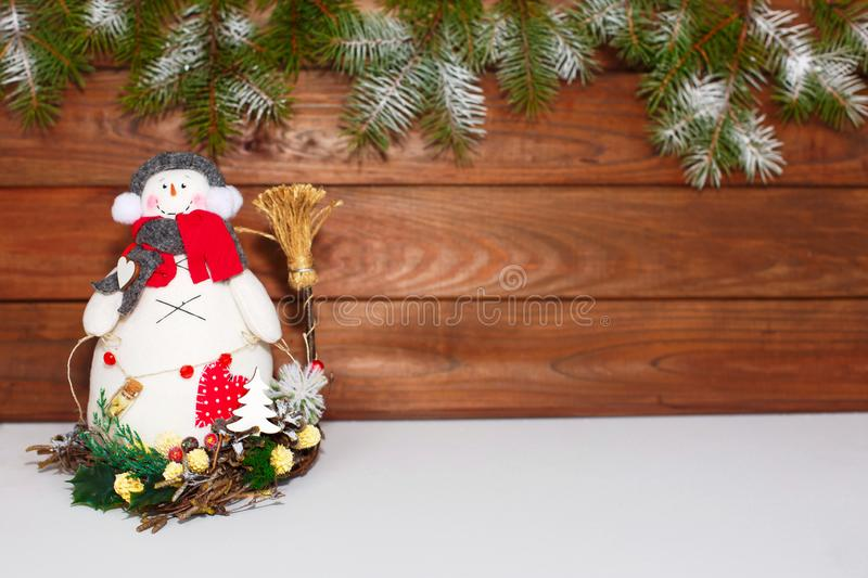 Happy Christmas snowman. Christmas decoration on a wooden background. Greeting card. Xmas decoration. Merry Christmas and a happy New Year card with snowmans stock image