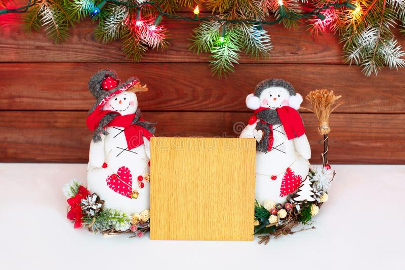 Happy Christmas snowman. Christmas decoration on a wooden background. Greeting card. Xmas decoration. Merry Christmas and a happy New Year card with snowmans stock photography