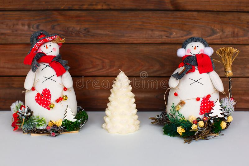 Happy Christmas snowman. Christmas decoration on a wooden background. Greeting card. Xmas decoration. Merry Christmas and a happy New Year card with snowmans royalty free stock photos