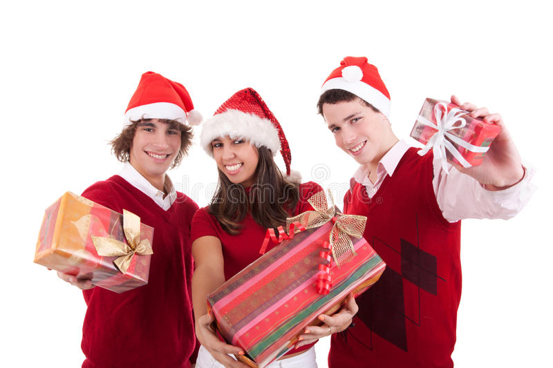 Happy christmas teens with gifts. Isolated on white background, studio shot royalty free stock photography