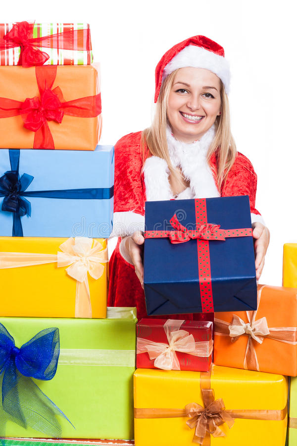 Happy Christmas woman giving presents stock images