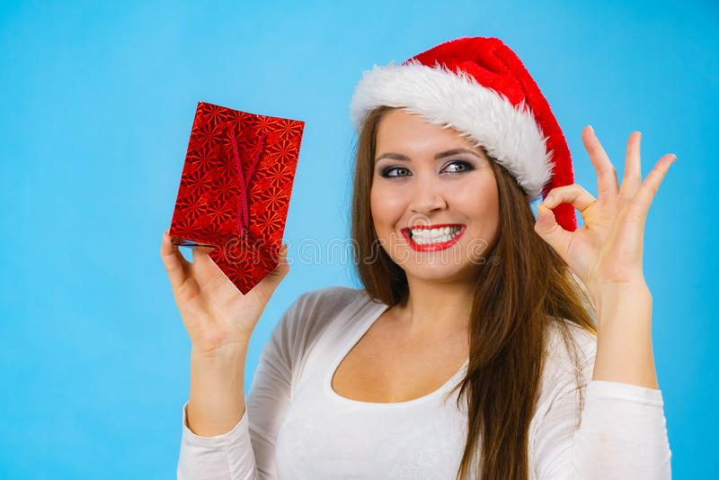Happy Christmas woman holds gift bag stock photos