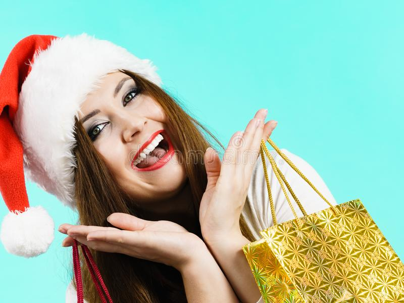 Happy Christmas woman holds gift bag royalty free stock photo