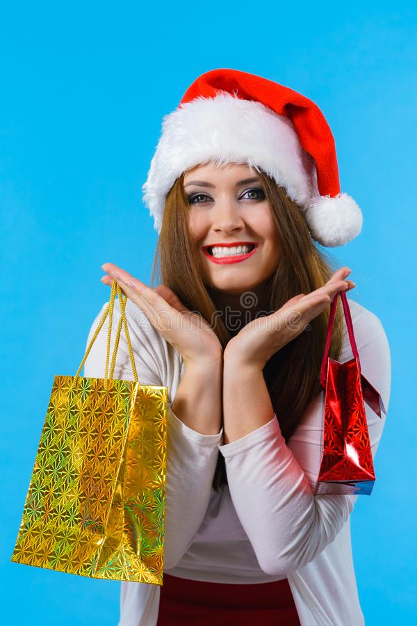 Happy Christmas woman holds gifts bag royalty free stock photos